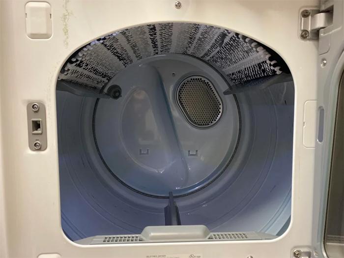 bath rug stuck inside washing machine