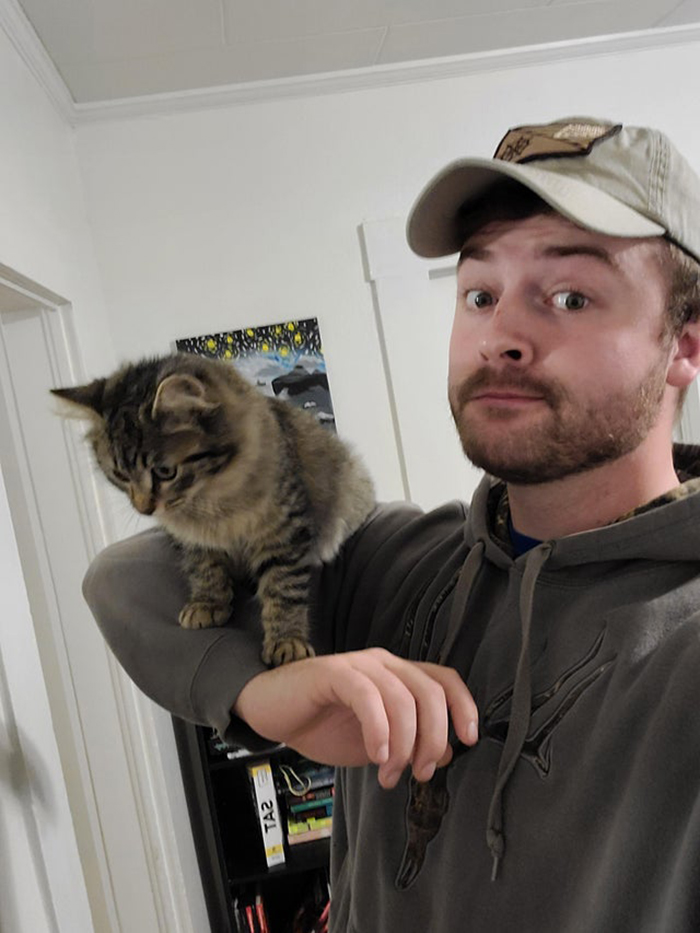 guy posing with new adopted cat