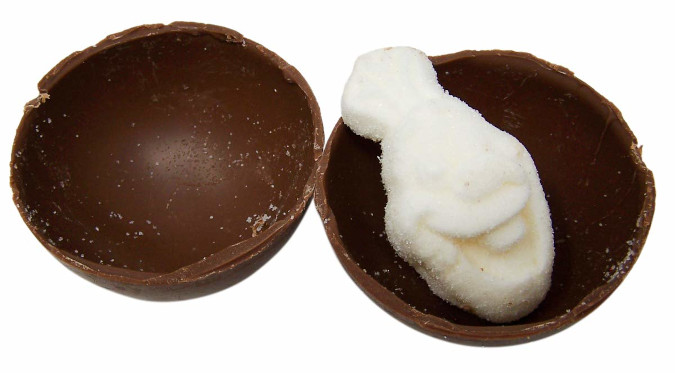 hot chocolate bomb cut in half to reveal olaf-shaped marshmallow