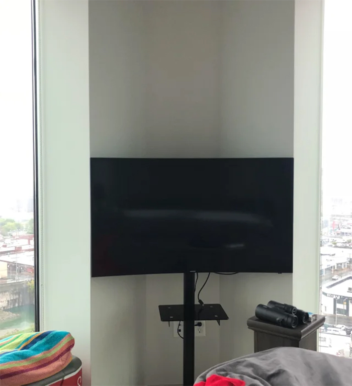 perfect things curved tv in bedroom corner