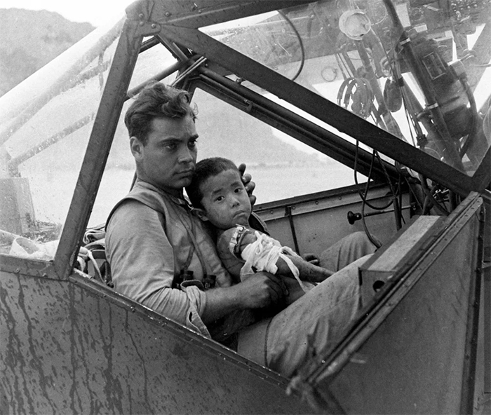 rare photos american soldier cradles a wounded japanese boy