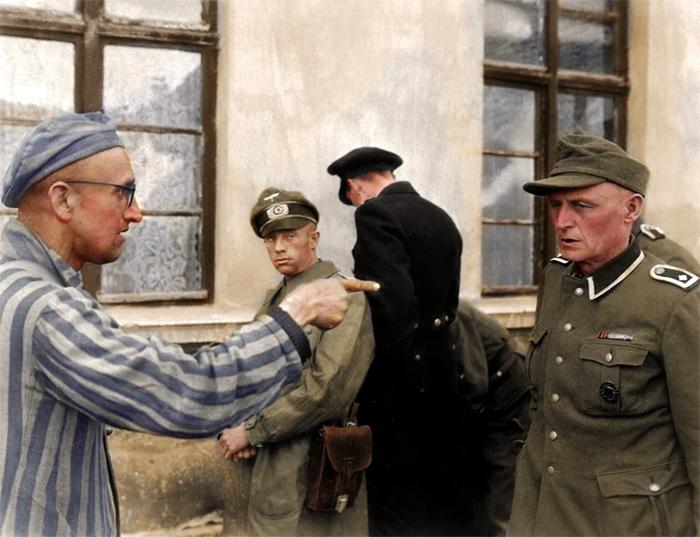 russian prisoner points at cruel nazi guard