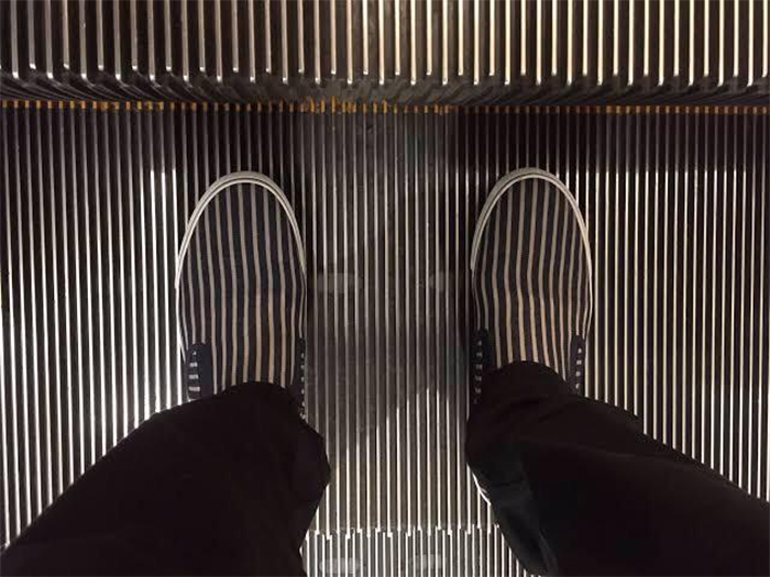 shoes align with escalator steps