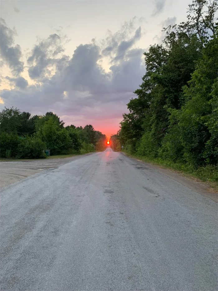 sun at the end of the road
