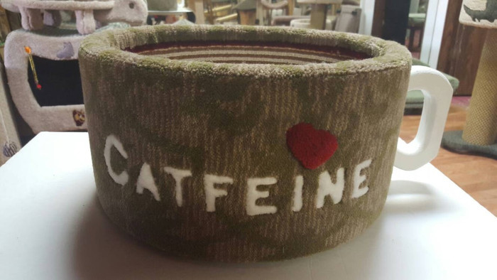 brown and moss green mug-shaped cat bed