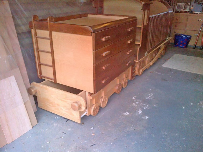 chest of drawers with changing station modeled after a coal cart attached to the train crib