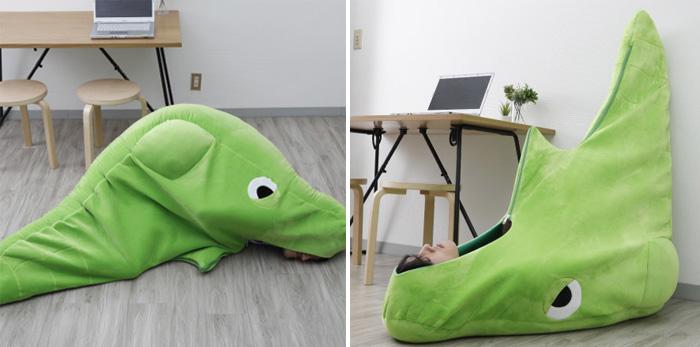 man napping inside bug type pokemon inspired bedroll