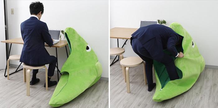 man using metapod sleeping bag in the office