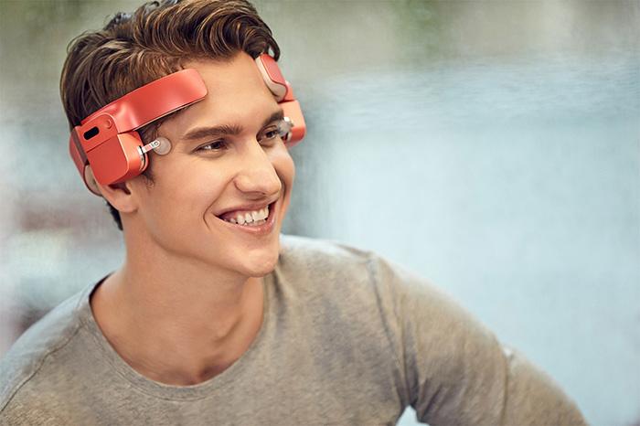 man wearing red lerou head massager