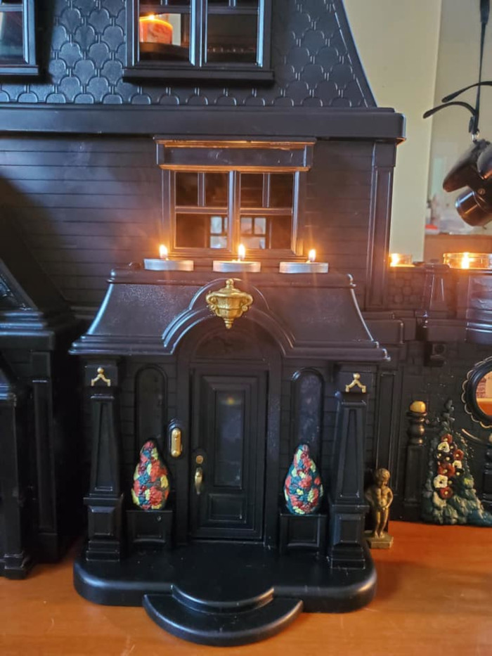 matte black tpy with subtle colorful details and lit candles