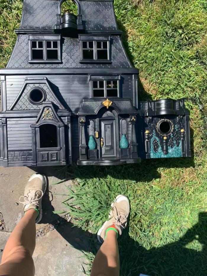 samantha adds subtle colors to the matte black dollhouse