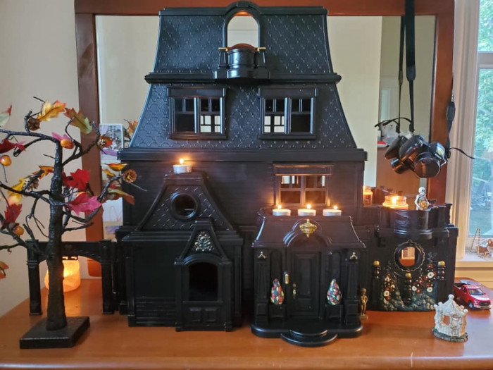 the black dollhouse staged for halloween