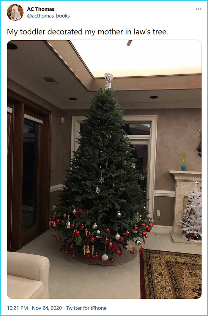 toddler half-decorated christmas tree
