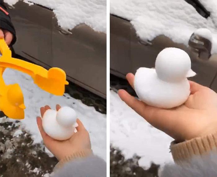 yellow duck-shaped snowball maker