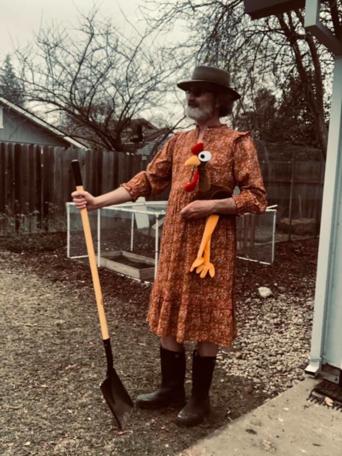 Andy Fell terrified his chickens when he came out wearing his orange prairie dress