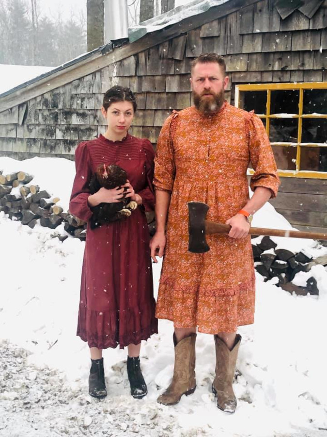 Cheri Lawrence Grovestein and husband in red and orange version of the Target prairie dress for their roasting