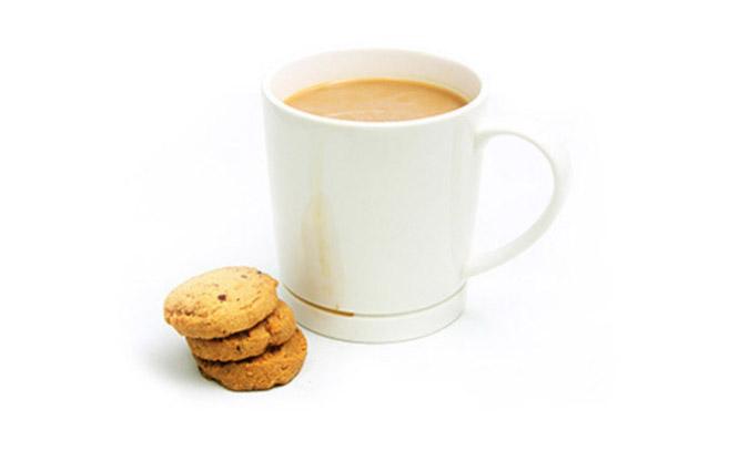 Drop-Rest Coffee Mug alongside a stack of cookies