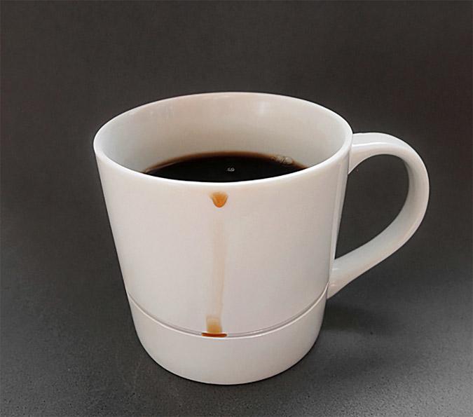 Drop-Rest Coffee Mug catching a coffee drip