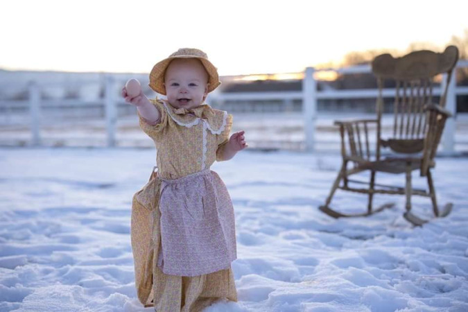 Melissa Tomas' young tot happily joins in on the family roasting of the Target prairie dress line