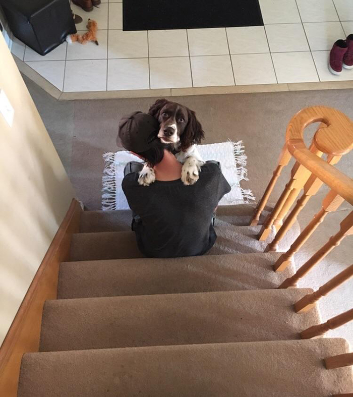 boyfriend giving dog hug