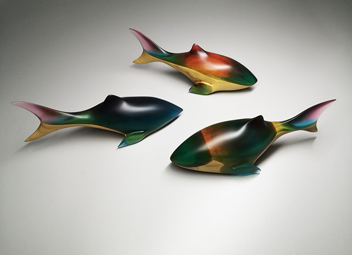 colorful wooden sharks with epoxy resin