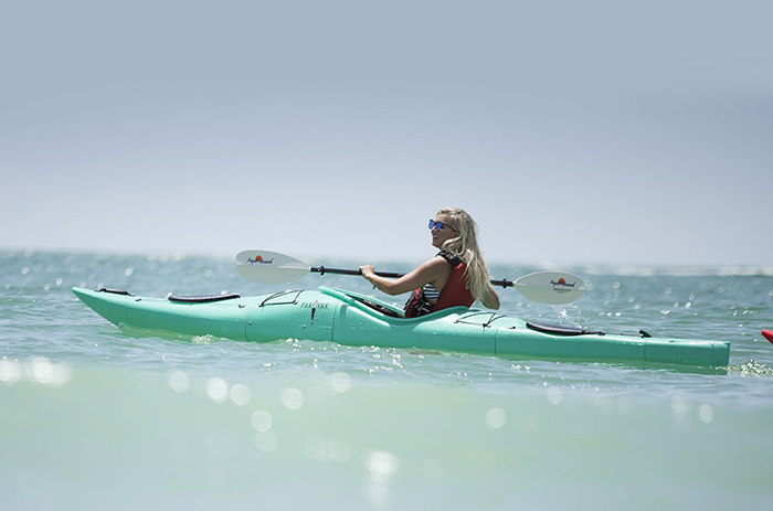 lady kayaking at the beach