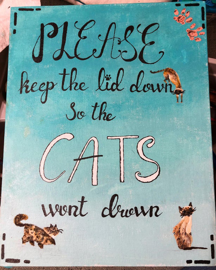pet owner warning sign keeping toilet lid down