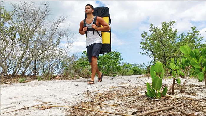 traveler bringing pakayak to the beach