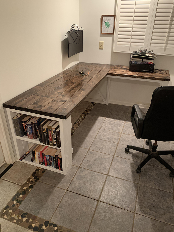 wooden desk with bookshelves