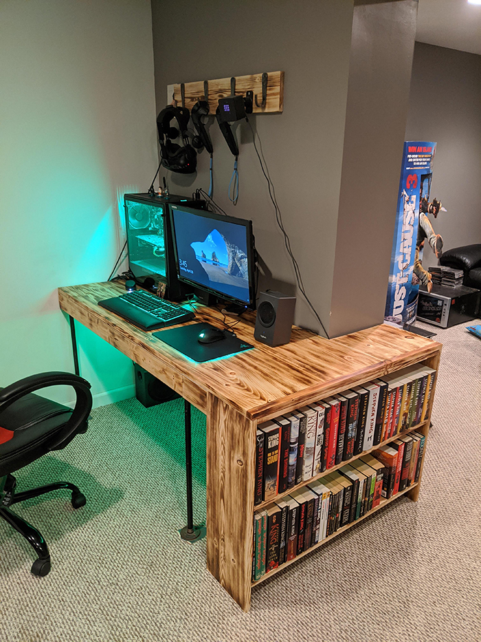 wooden desk with integrated bookshelves