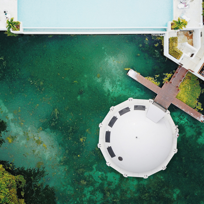aerial shot of the Anthenea docked at a residential area