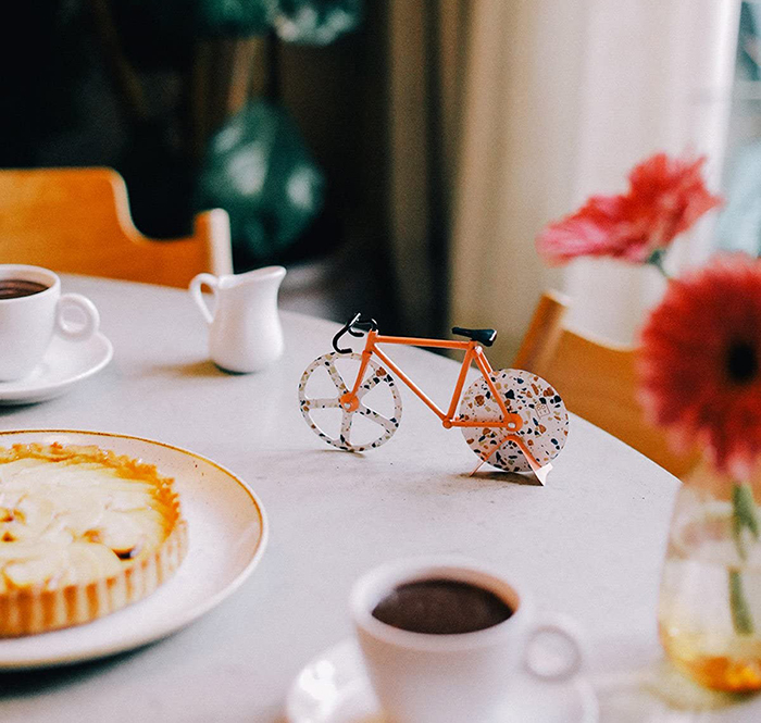 bike inspired pie slicer black and orange splatter design