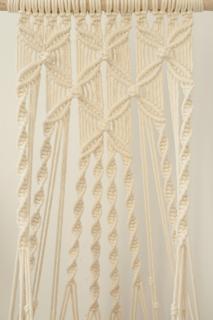 detail shot of the natural white flower-patterned hanging cat hammocks