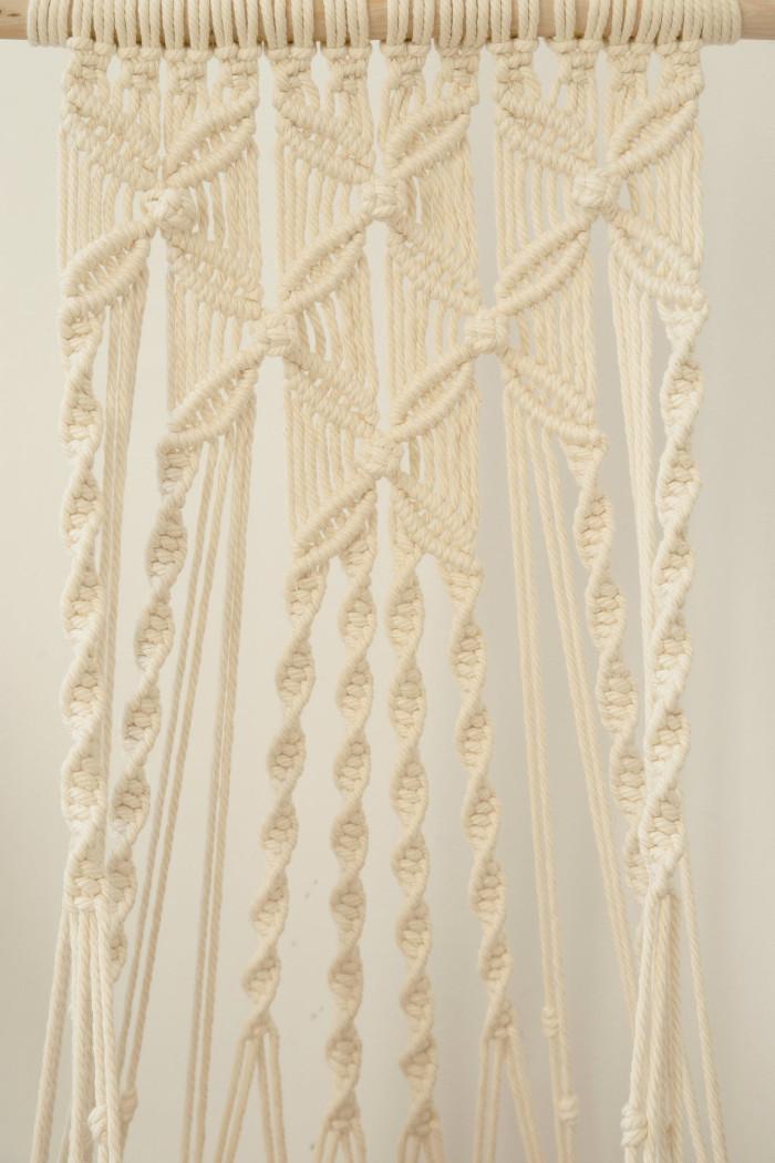 detail shot of the natural white flower-patterned hanging cat hammocks