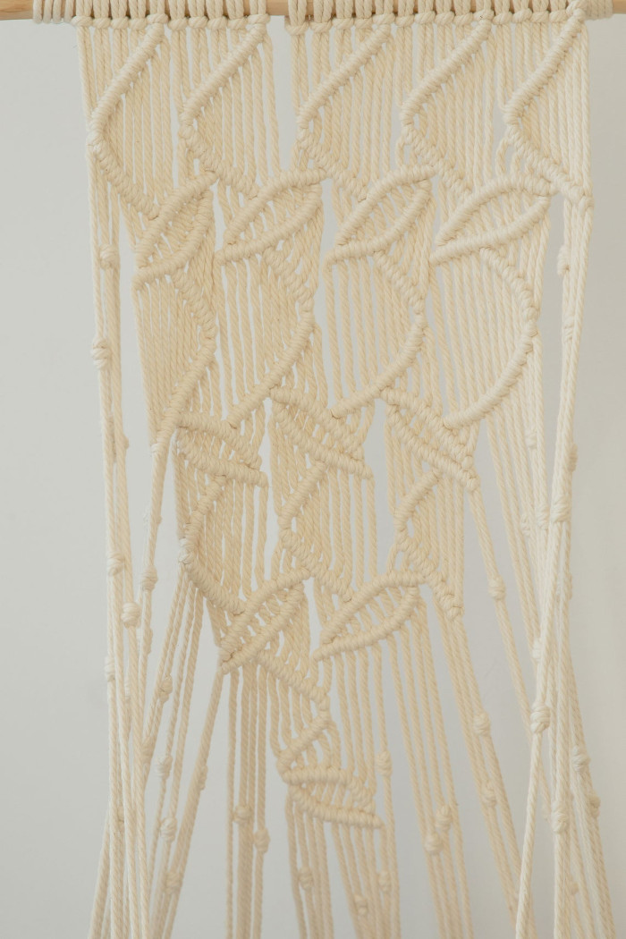 detail shot of the natural white leaf-patterned hanging cat hammock