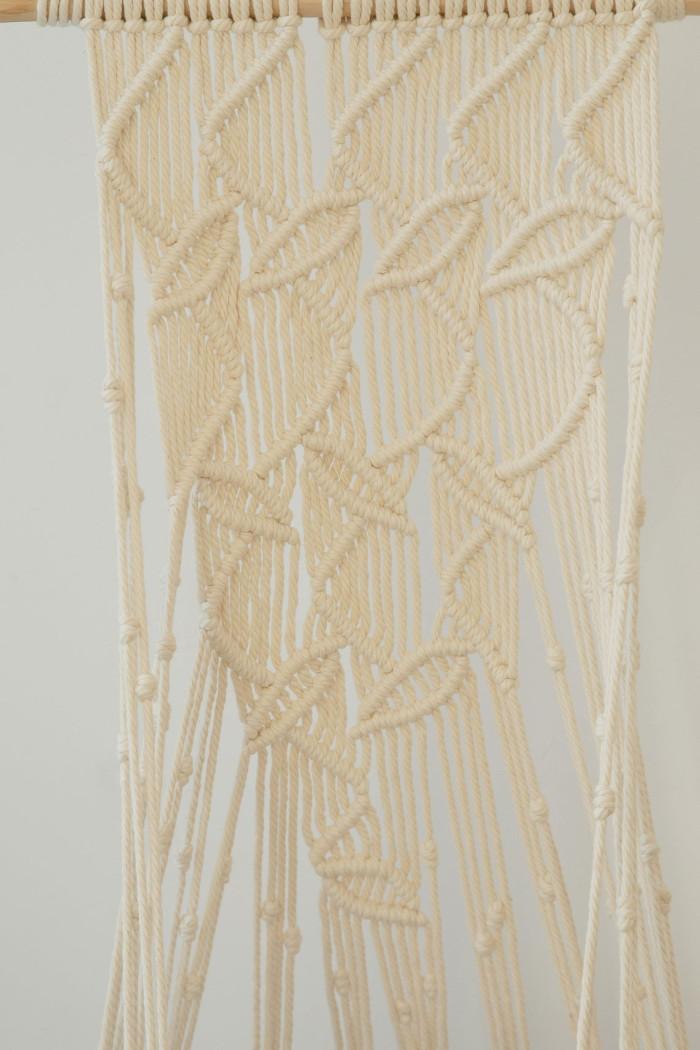 detail shot of the natural white leaf-patterned hanging cat hammock
