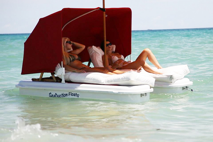 floating beach lounge chairs with umbrella and canopy attachments