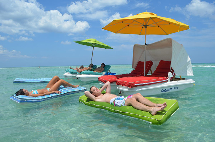 floating cabana loungers with attachable umbrella and canopy