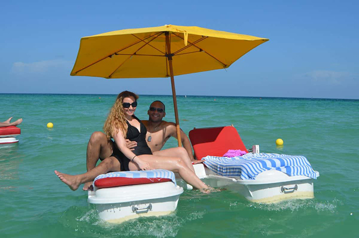 floating cabana loungers with canopy and umbrella attachments