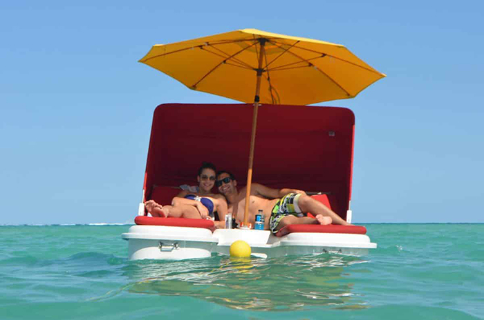 floating cabana loungers with umbrella and canopy attachments
