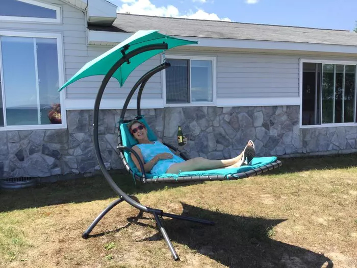 hanging curved chaise lounger backyard