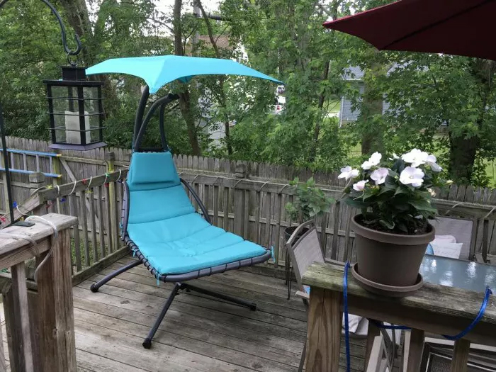 hanging curved chaise lounger patio