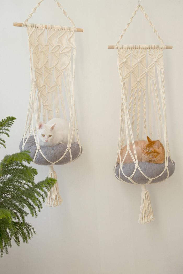 leaf and flower-patterned hanging cat hammocks side by side