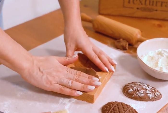 pressing dough into cast