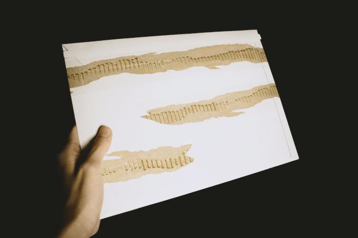 rip illusion on white letter-size envelope