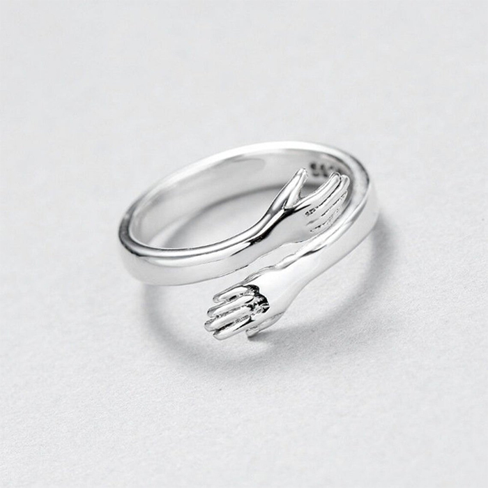 sterling silver jewelry embracing arm design