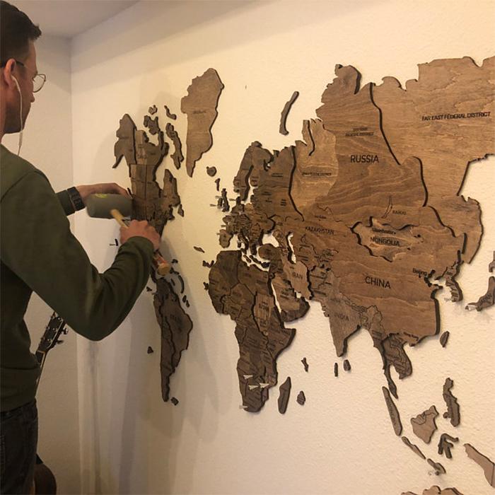 world map wall decor installation