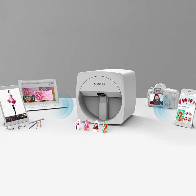 O'2Nails Digital Nail Printer in white surrounded by compatible devices it can receive pictures from
