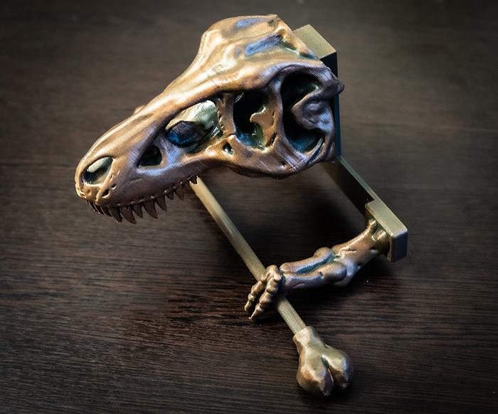 dinosaur skull tissue dispenser bronze