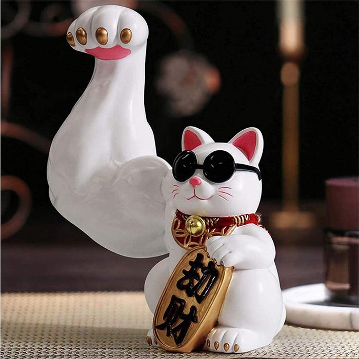 jacked waving cat statue buff paw